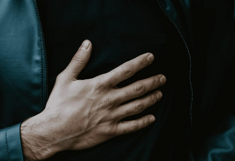 Hand on a chest - recurring heart attack